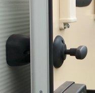 QUICK RELEASE BARREL DOOR RETAINER In Black or White